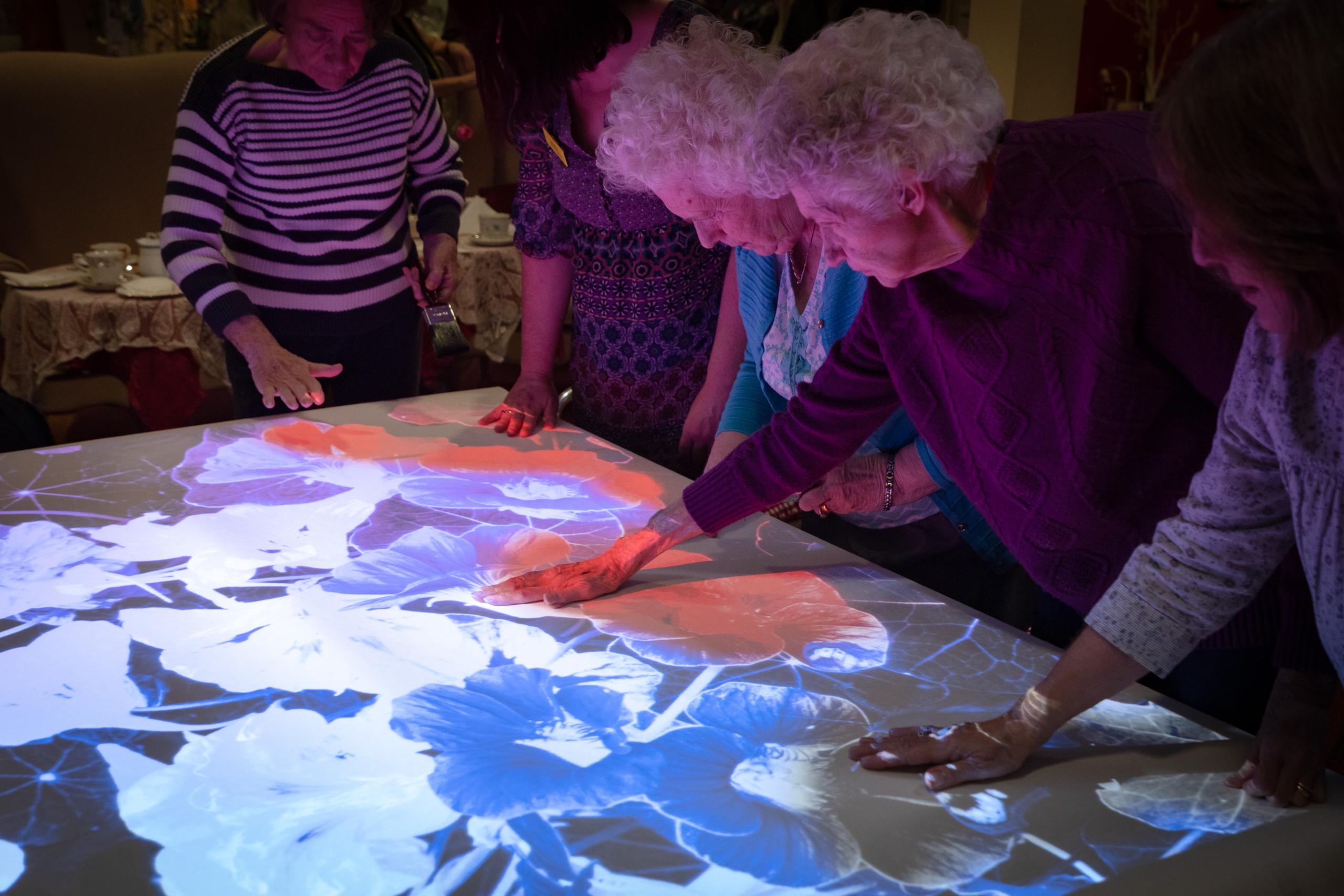 carey lodge residents enjoying sensory table top painting activities
