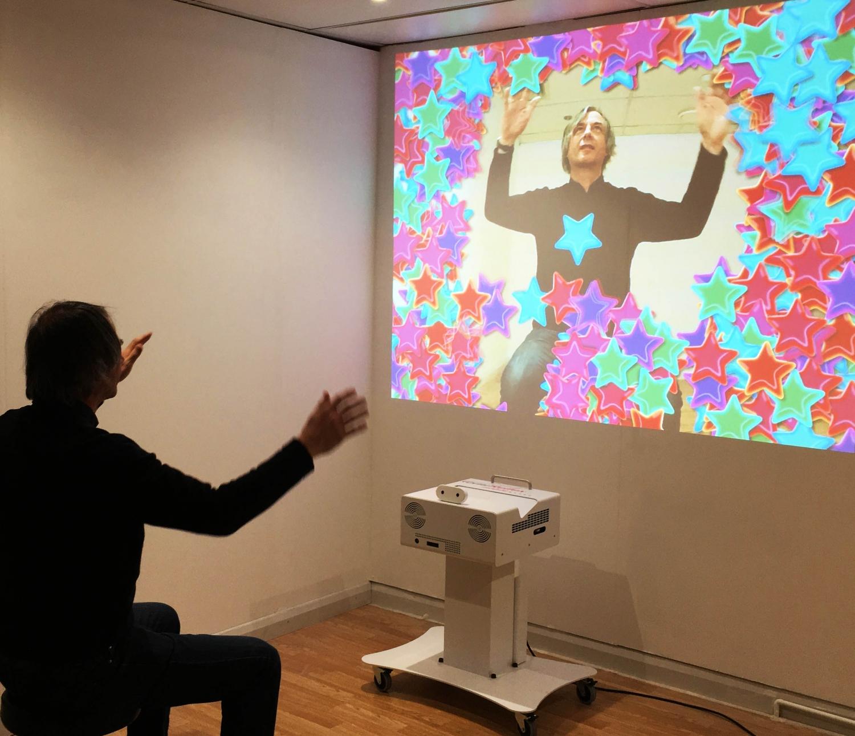 demonstrating the omiReflex interactive sensory wall projector