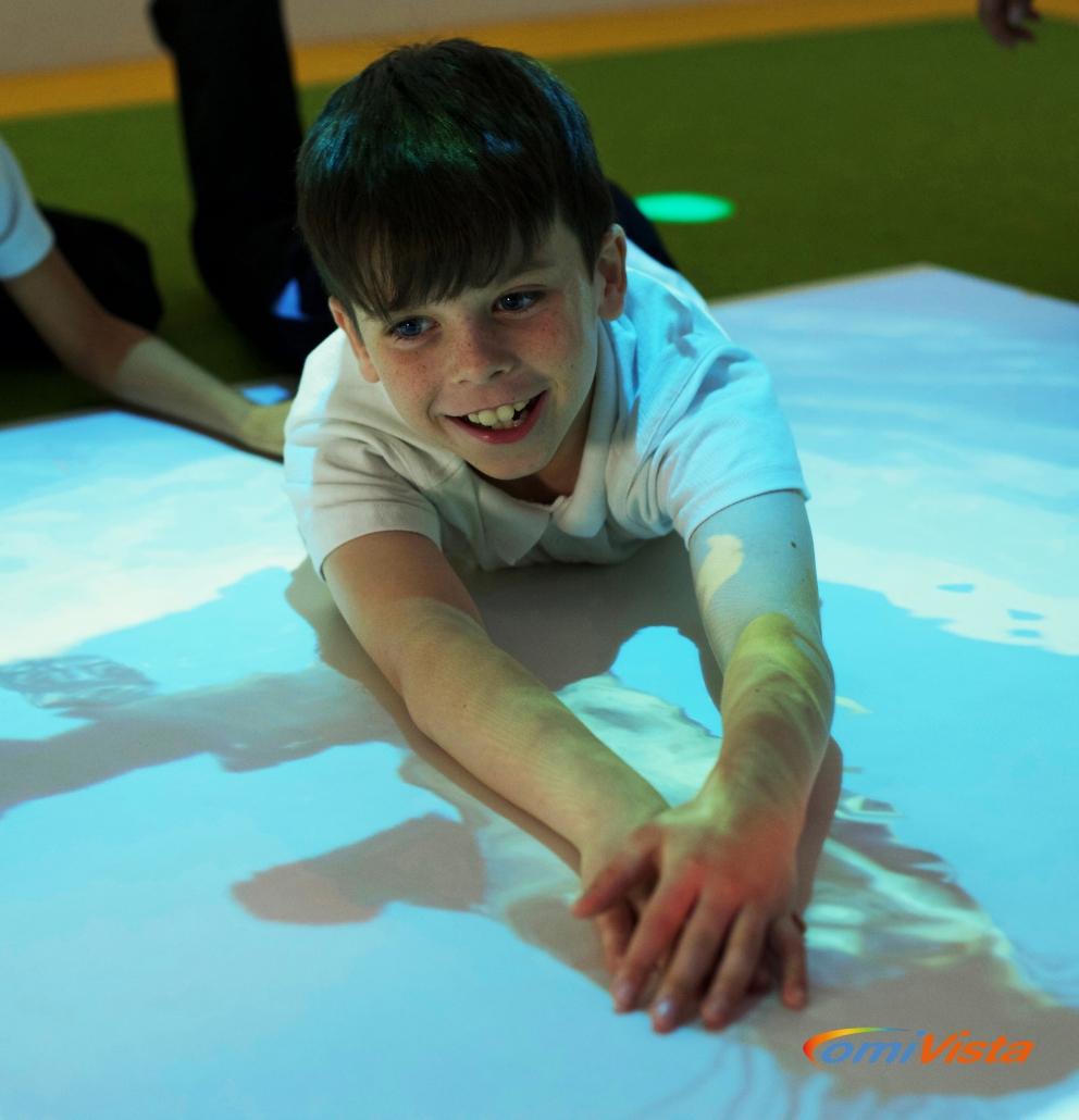 interactive activities on magic carpet sensory floor in special needs classroom