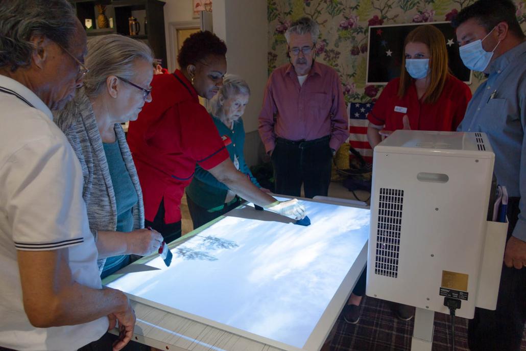 activities coordinator using interactive sensory table