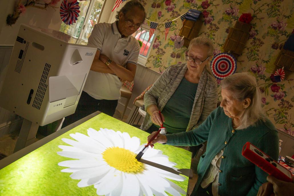 elderly resident using sensory paining activity